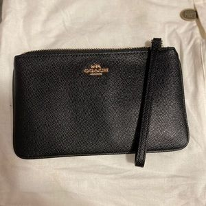 Coach black pebble wristlet with gold hardware